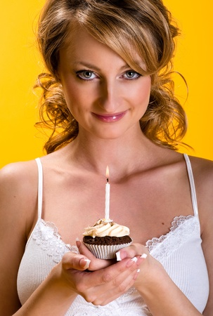 Beautiful young woman with birthday cake  photo