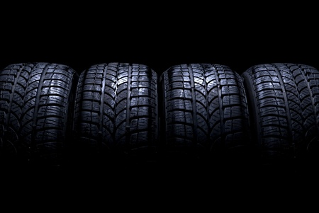tyre tread: Car tires isolated on black background