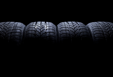 Car tires isolated on black background  Stock Photo - 9653139