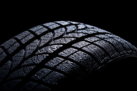 tyre tread: Car tire isolated on black background Stock Photo