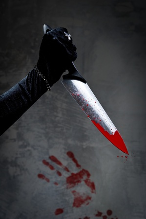 Female hand with bloody knife  photo