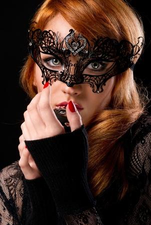 Beautiful redhead woman with retro microphone  photo