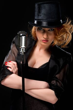 Gorgeous stylish redhead woman with retro microphone  photo