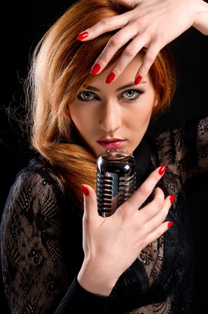 Gorgeous redhead woman with retro microphone  photo