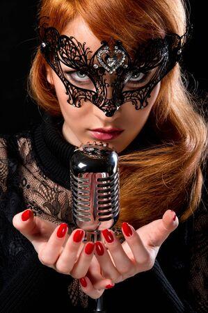 Gorgeous redhead woman singing  photo