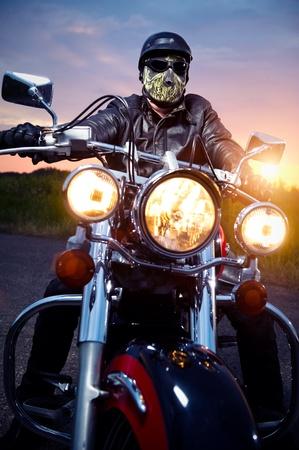 Biker on the motorbike outdoors