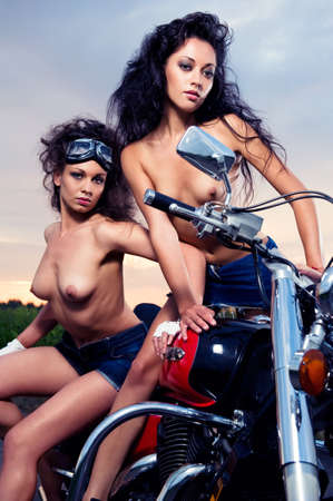 Two sexy young woman sitting on the motorcycle outdoors Stock Photo - 9846018