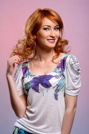 Beautiful redhead young woman smiling photo