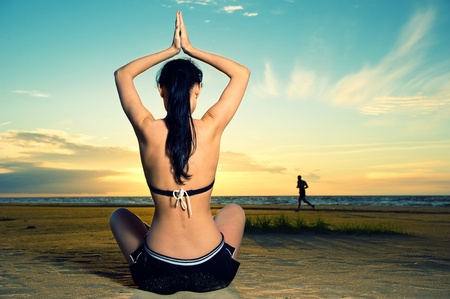 Woman doing yoga exercise outdoors  photo
