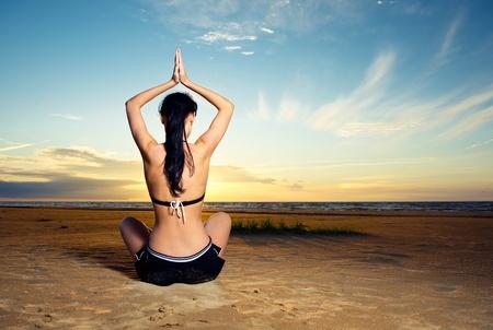 yoga outside: Woman doing yoga exercise outdoors Stock Photo