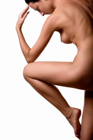 nude female buttocks: Beautiful female body isolated over white background