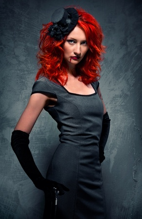 Gorgeous redhead woman with blood on her lips photo