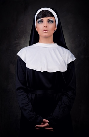 Portrait of young attractive nun photo
