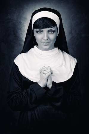 Young attractive nun indoors photo