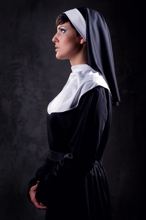 Young attractive nun indoors Stock Photo - 11261034