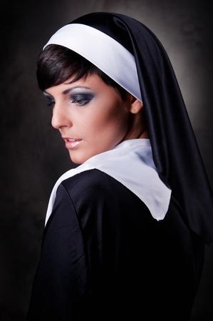 Portrait of young beautiful nun photo
