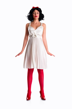 Beautiful female wearing white dress and red stockings on white background photo