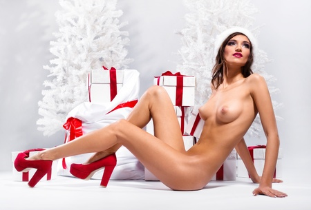 Beautiful naked female posing over winter background Stock Photo