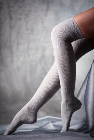 Beautiful woman legs in grey stockings  photo