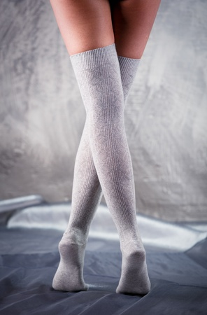 Beautiful woman legs in cotton stockings  photo