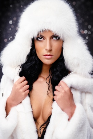 Beautiful woman in white fur coat and cap Stock Photo - 11958884