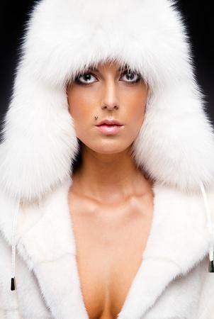 Beautiful woman in white fur coat and cap Stock Photo - 11958881