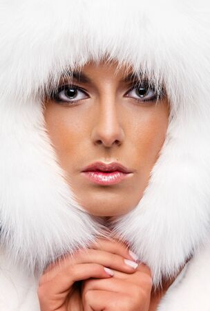 Portrait of a beautiful woman in white fur cap Stock Photo - 11958883