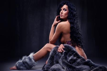 Gorgeous brunette in fur posing indoors photo