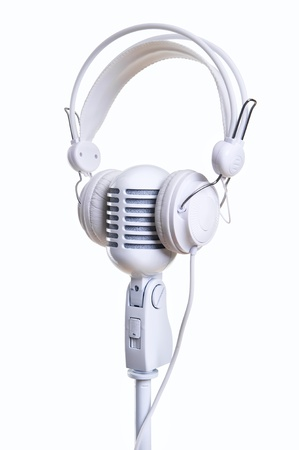 White microphone and headphones over white background photo