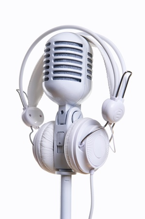 sound recording equipment: White microphone and headphones over white background