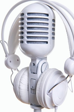 White microphone and headphones over white background Stock Photo - 12407356