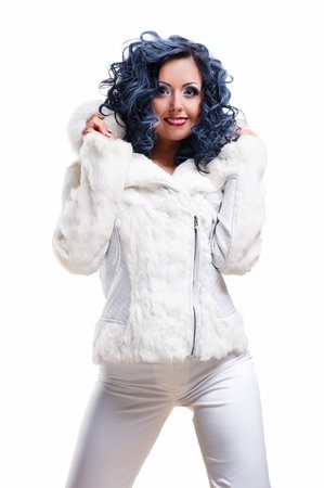 Beautiful brunette in white fur coat photo