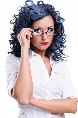 Young woman wearing glasses posing over white background photo