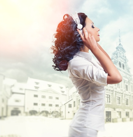 Beautiful woman listening music with headphones photo