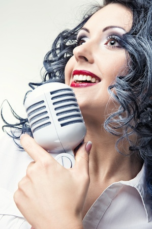 Beautiful young woman singing photo