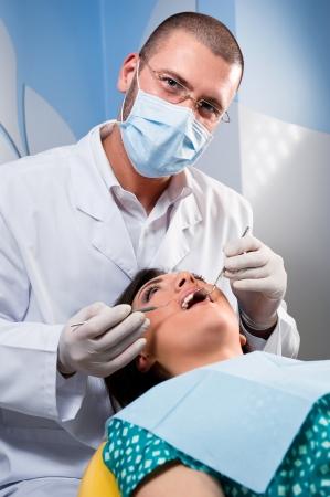 Teeth checkup at dentist photo