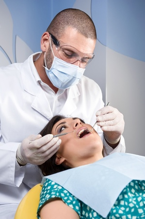 examined: Female patient having her teeth examined by specialist Stock Photo