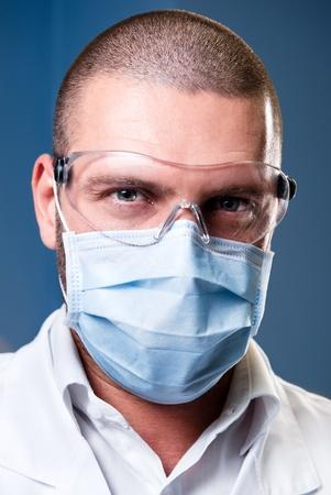 Portrait of a serious confident doctor photo