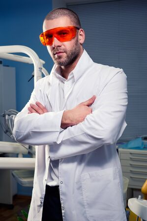 Confident successful doctor at dental clinic Stock Photo - 12666070
