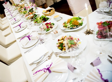 Luxury banquet table setting in restaurant photo