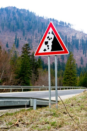 Falling stones, road sign photo