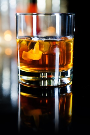 Glass of whiskey with ice cubes and fruits Stock Photo