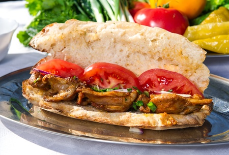 turkish kebab: Lavash with grilled meat and vegetables