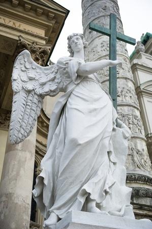 Angel statue  neat The St. Charless Church (Karlskirche), Vienna  photo