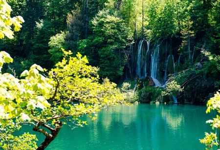 Beautiful waterfall in the Plitvice Lakes National Park in Croatia photo