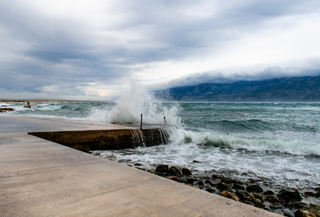Dark sky with clouds and stormy waves in the sea Stock Photo - 13750543