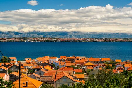 sea of houses: Beautiful landscape with orange houses, turquoise sea and blue sky, Croatia