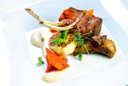 Juicy lamb steak on a plate close-up photo