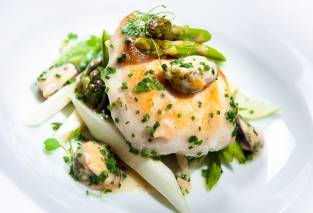 haddock: Delicious dish with fish fillet, asparagus and herbs on a plate Stock Photo