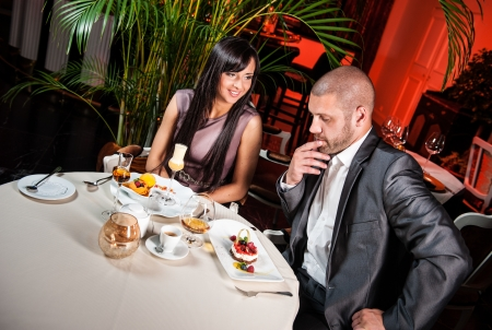 Beautiful couple in a restaurant on romantic date photo